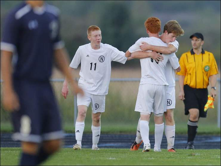 Northview players Andrew Klein (11) Brandon Osborn (16) and Matt Bules (10) celebrate Bules' goal against St. John's.