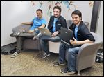 Dan Paquette, left, Jake Warner, and Alexander Mattoni, founders of Petrichor, meet up at Seed Coworking. Petrichor, a Toledo software start-up, is beginning to attract interest from investors.