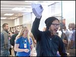 Rob Beckett of Portland, Mich., is cheered as the first to leave with an iPhone 6 from the Apple store in Grand Rapids, Mich.