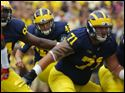 University of Michigan player Matt Wile (45) kicks a field goal against Utah during the first quarter.
