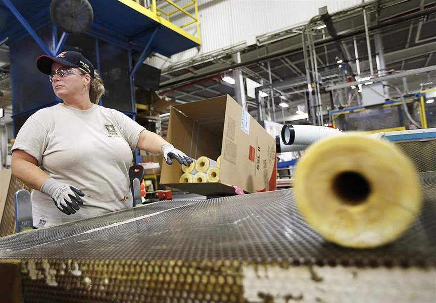 Wrap operator Malissa Moran waits for a tube of pipe insulation while she boxes product in the pipe factory at Owens Corningu0027s flagship plant in central ...  sc 1 st  Toledo Blade & Owens Corning facility in Newark a tight-knit family - The Blade
