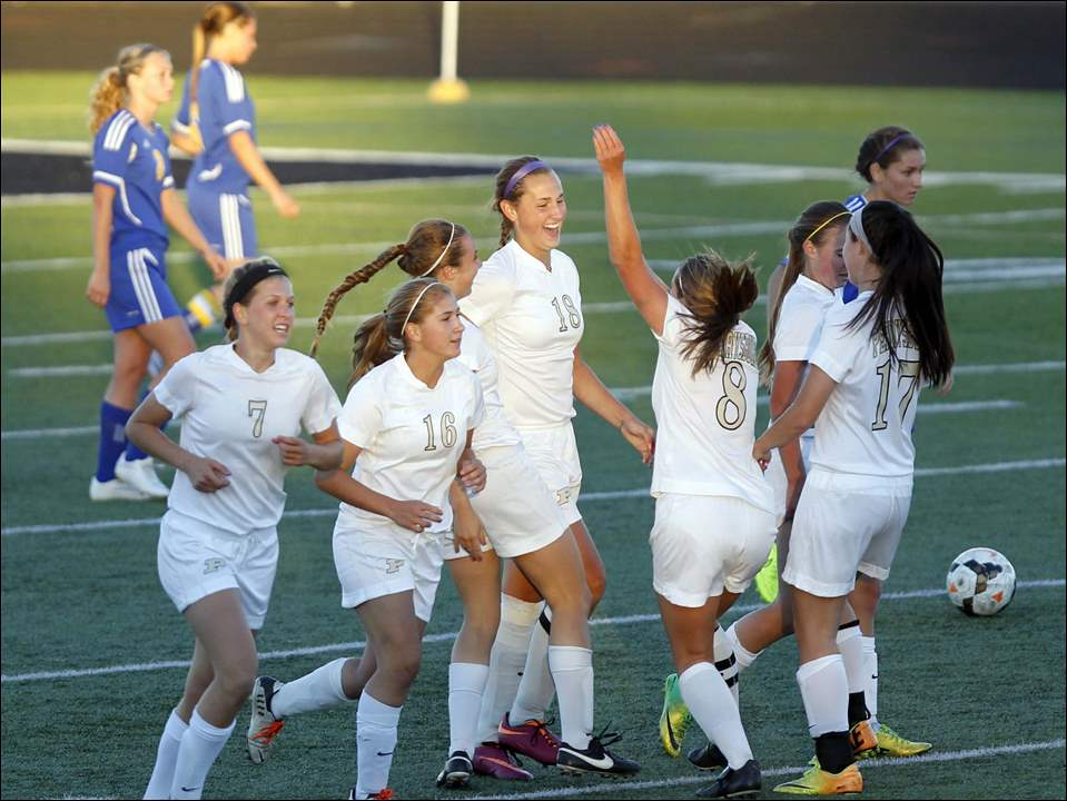 Perrysburg's Allex Brown (18), center, celebrates her goal with teammates.