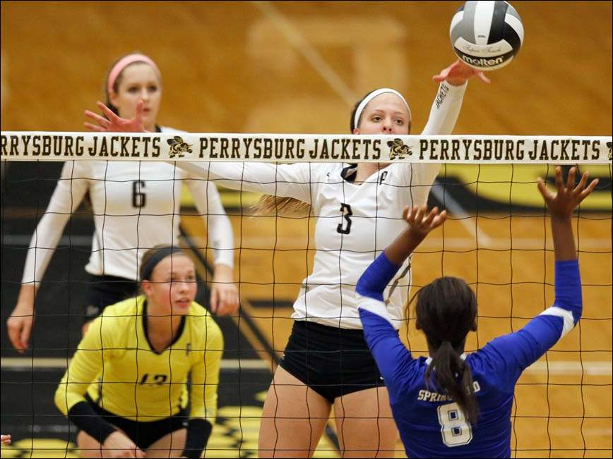 Perrysburg's Shannon Fastnacht (3) spikes the ball against Springfield's Asia Parker (8).