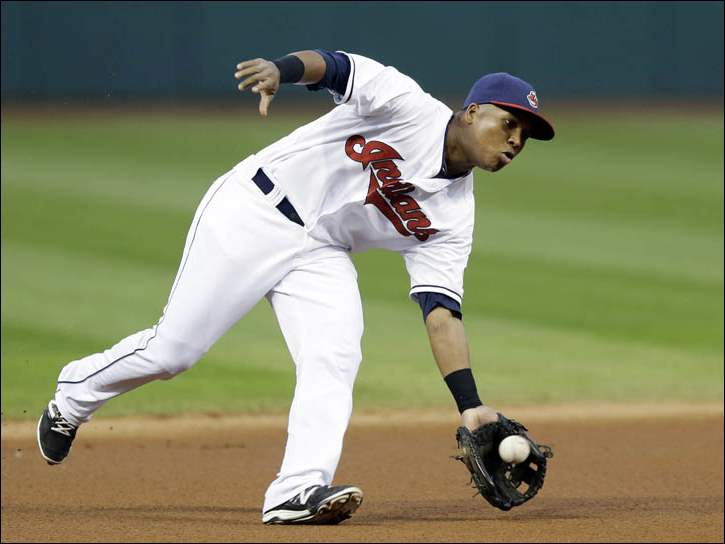 Cleveland Indians' Jose Ramirez fields a ball hit by Kansas City Royals' Alcides Escobar.