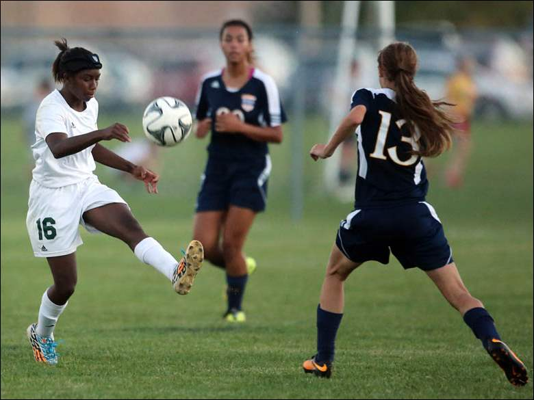 Clay's Alex Vartorella (6) kicks the ball against Notre Dame's Ashley Zenker (13).
