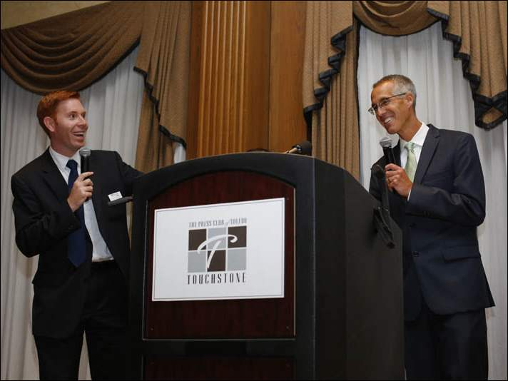 Shaun Kegarty, left,  and Lee Conklin speak after accepting an award at the 2014 Touchstone Awards.
