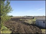 The site of the proposed Perrysburg Costco store, at the southeast corner of State Rt. 25 and Eckel Junction Road, is being cleared of homes and trees.