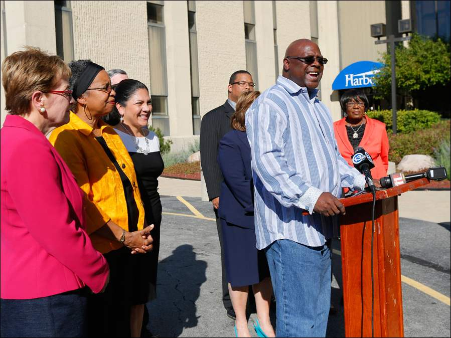 Rev. Willie Perryman, Pastor Jerusalem Baptist Church, joins Congresswoman Marcy Kaptur and local Democrats to speak about early voting in front of the Early Vote Center.