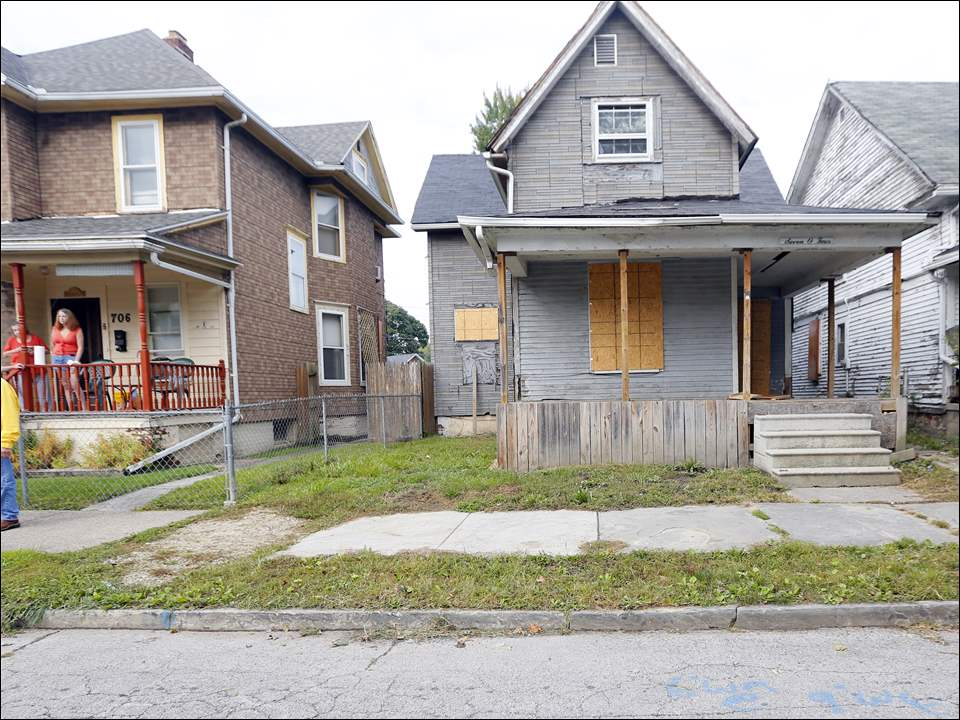 The home where Elaina Steinfurth was killed, 704 Federal St. in East Toledo, is boarded up and ready to be demolished.