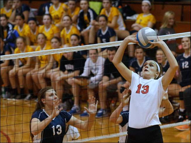 Saline's Kara Rogers watches Bedford's Isabelle Marciniak set the ball.