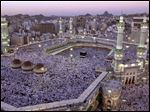 In this Monday, Feb. 18, 2002 file photo, thousands of Muslims gather around the holy Kabaa during evening prayer in the holy city of Mecca in Saudi Arabia.