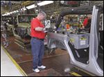 Work on the Jeep Wrangler assembly line at Chrysler Toledo Assembly Complex in Toledo.
