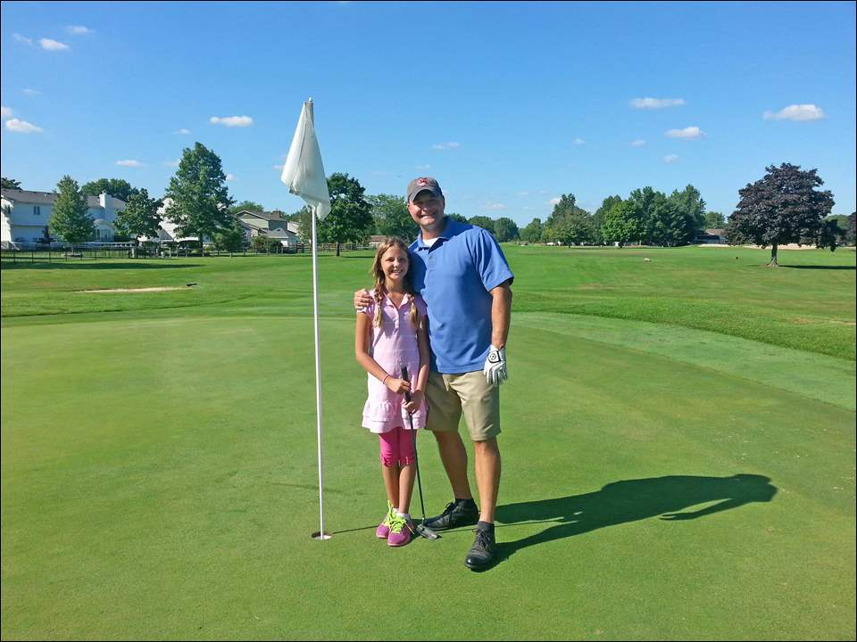 Molly and Greg Boros participate in the Ballet Theatre of Toledo's Parent Child Golf Outing at Brandywine Country Club.