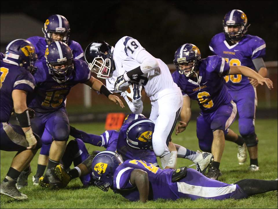 Napoleon's junior Joseph France (19) is taken down on the short run by the Maumee defense during the fourth quarter.