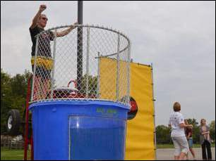 Students at Highland Elementary raised more than the goal of $15,000 a the annual walkathon, earning them the right to dunk Principal Mark Pugh.