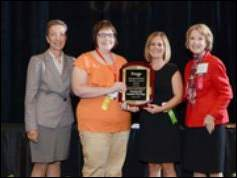 When Otterbein received its service award, Kathryn Brod, left, LeadingAge Ohio president and CEO is shown, from left to right, with Megan Vandyke, quality of life coordinator for Otterbein Perrysburg; Katie Gulgin, guide for Otterbein Perrysburg; and Adrienne Walsh, professional recognition committee chair and president/CEO of Bayley.