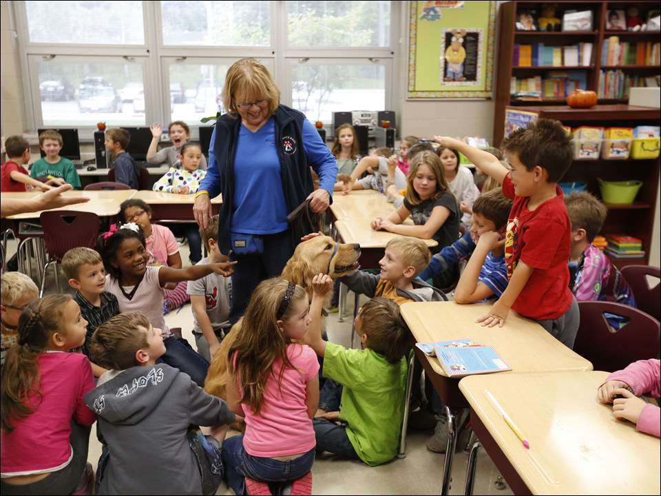 Judy Eckel, of Maumee, lets the children pet Lansbury during class.