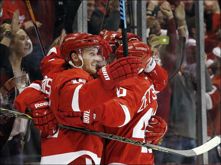 Detroit Red Wings center Gustav Nyquist, celebrates his goal against the Boston Bruins with teammates.
