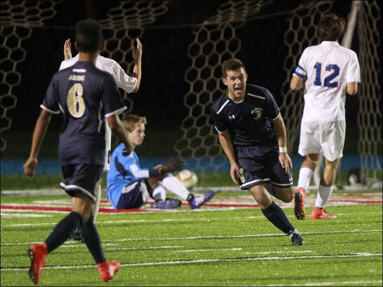 St. John's Camden Buescher, center, celebrates his second goal against St. Francis.