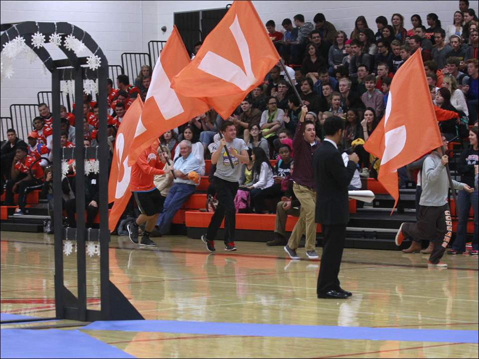 Students wave flags to incite spirit during the homecoming celebration at Southview High School.