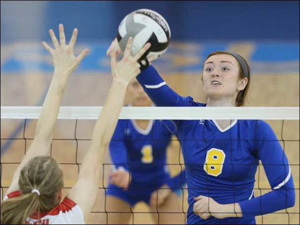 St. Ursula's Lauran Graves (8) spikes the ball against Central Catholic's Molly Hartlage (11).