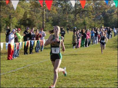Haley Hess, of Clay High School, finishes first in the Girls' meet.