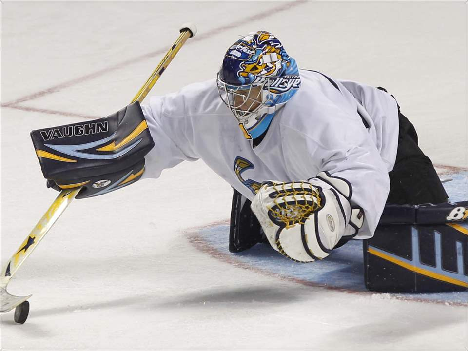 Toledo Walleye's goalie Jeff Lerg makes a save.