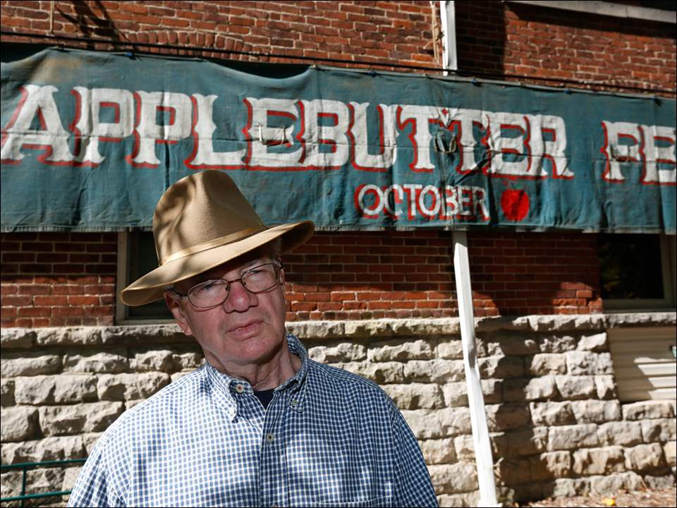 Steve Kryder, co-chairman of the Applebutter Fest, and president of the historical Society of Grand Rapids, near the apple butter-making area.