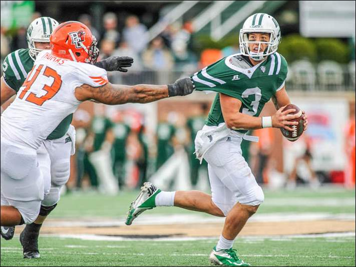 Ohio Bobcats quarterback JD Sprague (3) is pulled to the ground for a sack by Bowling Green Falcons defensive end Bryan Thomas (43).