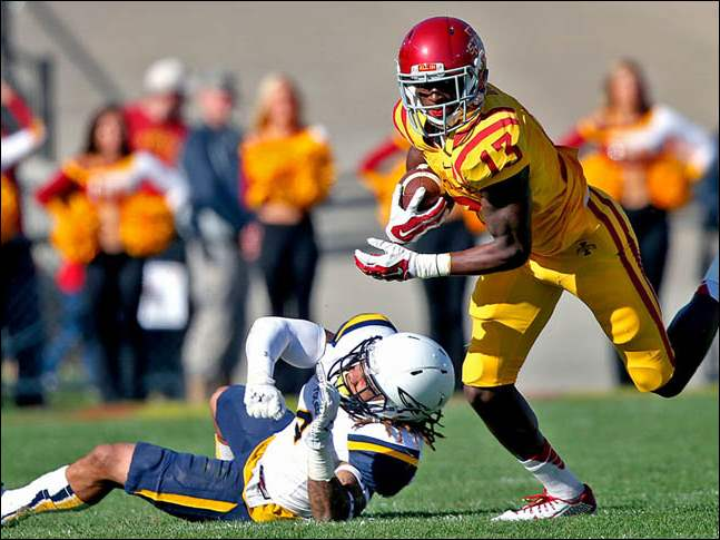 After the catch, Iowa State's #13 Dondre Daley, right, made a move to spin away from Toledo's #4 Jordan Haden.