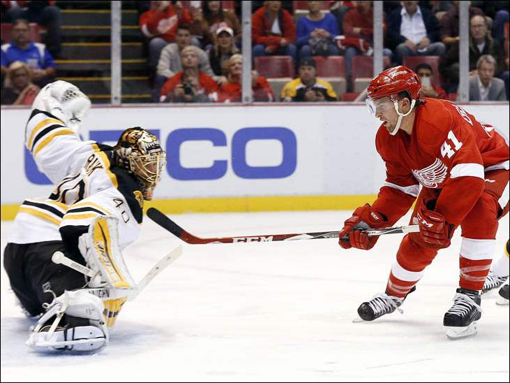 Boston Bruins goalie Tuukka Rask (40) stops a shot by Detroit Red Wings right wing Luke Glendening (41).