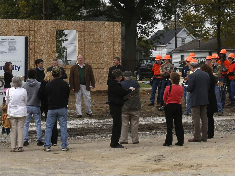 Penta Career Center students participate in a Wall Raising Ceremony for home owner Alex Coronado at the construction site of her home on Bacon St. in Rossford, Ohio.
