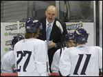 Toledo Walleye head coach Derek Lalonde talks to players during the second period of the preseason game against Kalamazoo Wings.