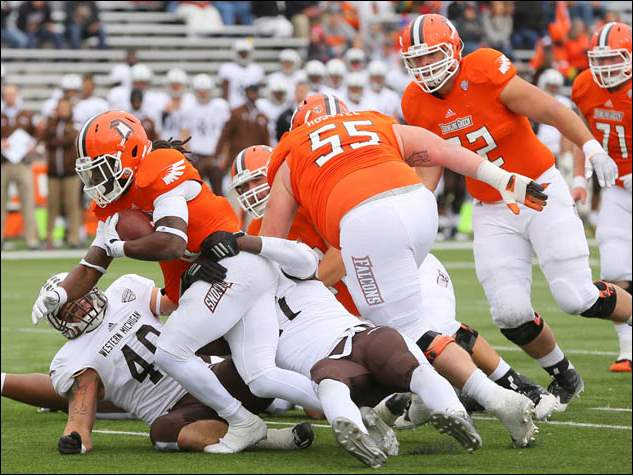 Bowling Green State University RB Travis Greene (8) runs the ball against Western Michigan.