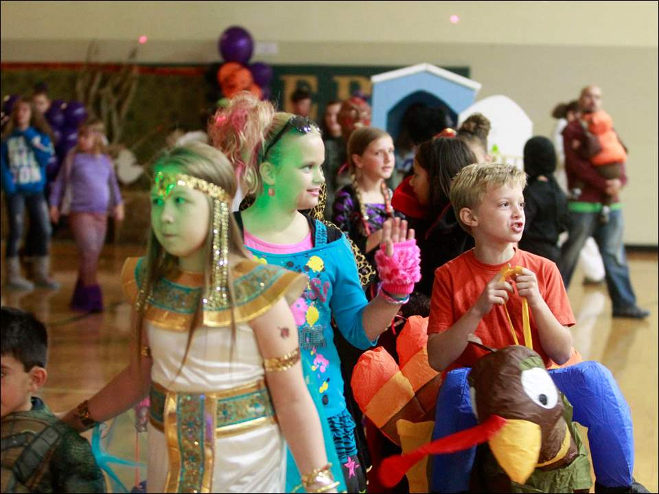 Children line up to show off their costumes during Halloween Extravaganza.