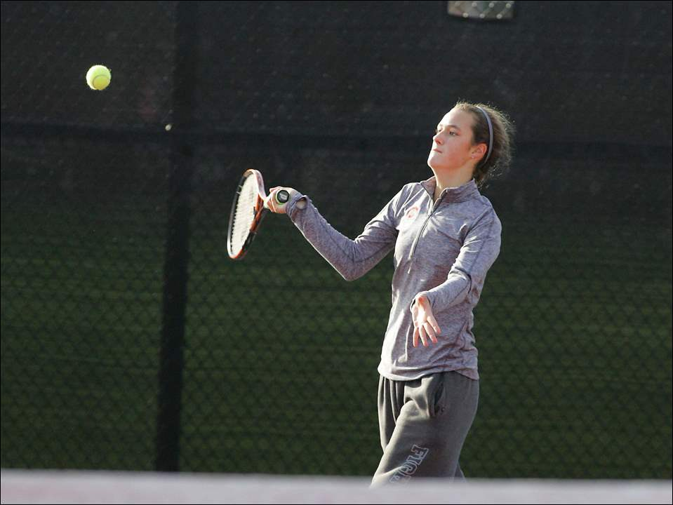 Central Catholic freshman Sophia Spinazze returns a serve during her first round match versus Alexandra Cash of New Albany.