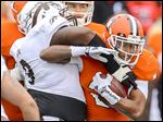 BG's Fred Coppet attempts to get past Western Michigan's Isaiah Gourdine. Coppet had nine carries for 26 yards.