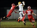 Bryan WR Gavin Saul (8) makes a catch as Wauseon DB Ty Leininger (14) defends.