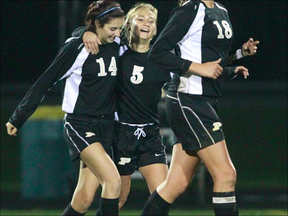 Perrysburg's players from right, Allex Brown, Bri Boyd, and Emily Baer celebrate their win against Ashland.