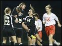 Perrysburg's Kayla Curson is raised and celebrated by her teammates after scoring.