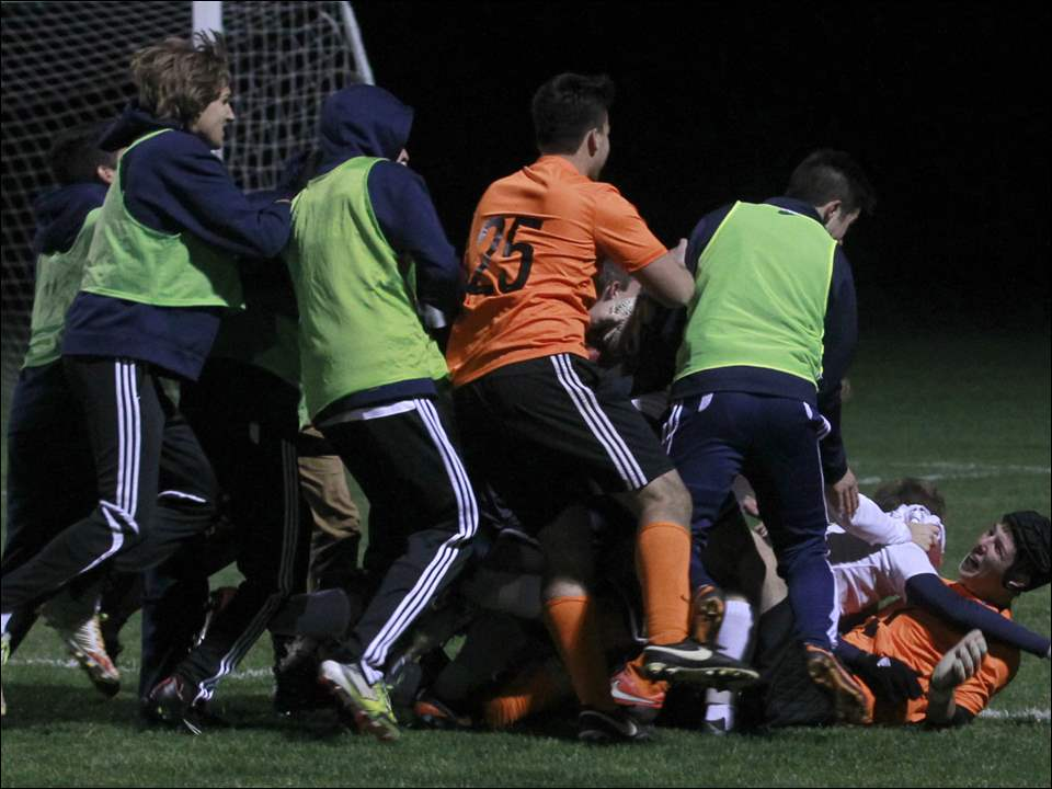 St. Johns' goalie Jerrett Karalfa, bottom right, is at the bottom of a pile after St. John's defeated Northview.