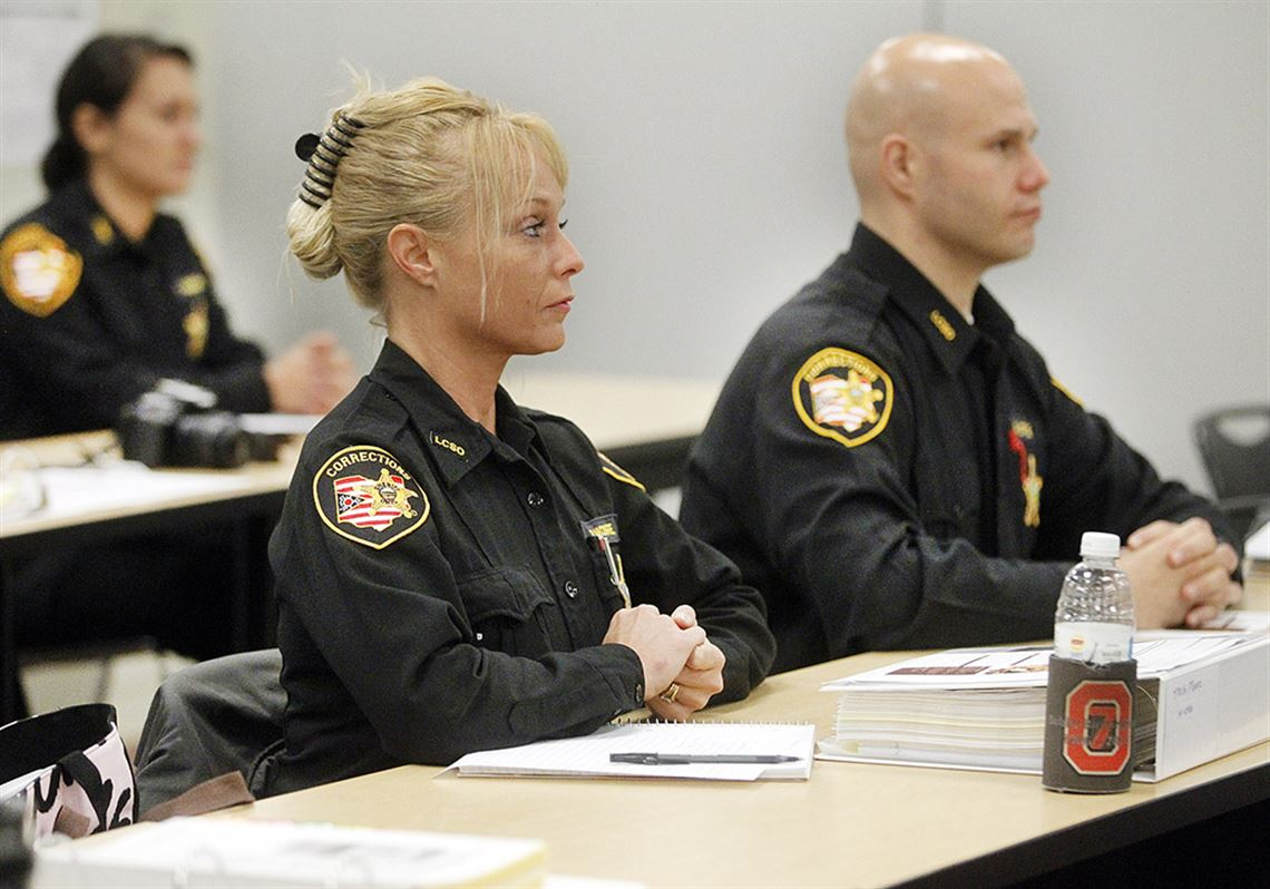 Lucas County Corrections Officer Trish Moore listens as Sheriff John Tharp  speaks to officers as they. 2. Sheriff addresses deputy trainees