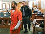 Jaequan Smith is led from the courtroom of Judge Gene Zmuda after being sentenced Wednesday.