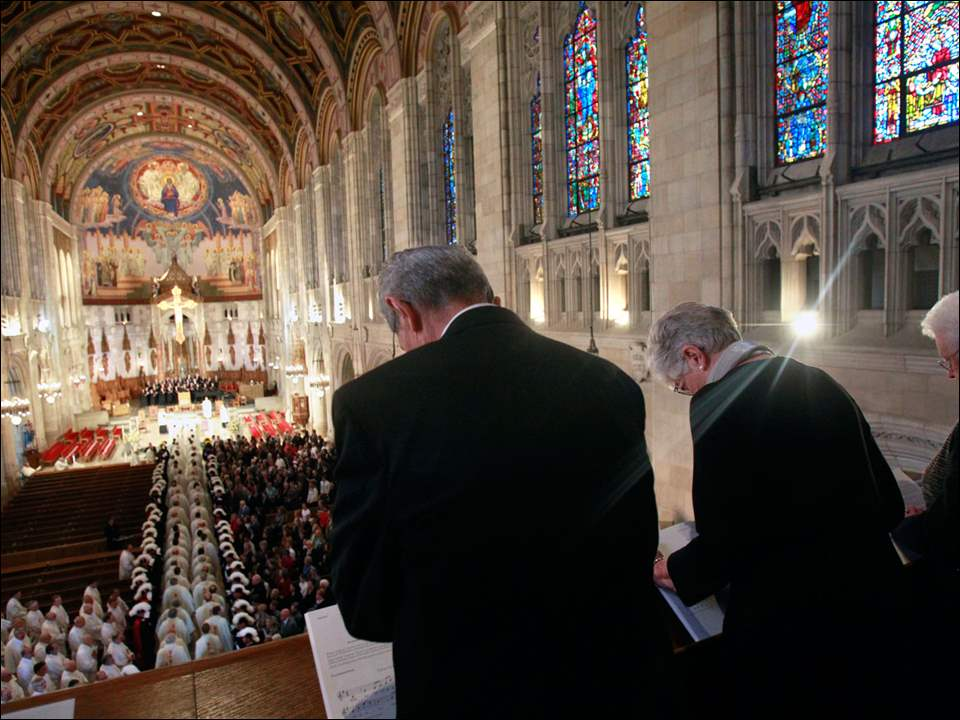 Diocese of Toledo's employees attend the beginning of the installation ceremony.