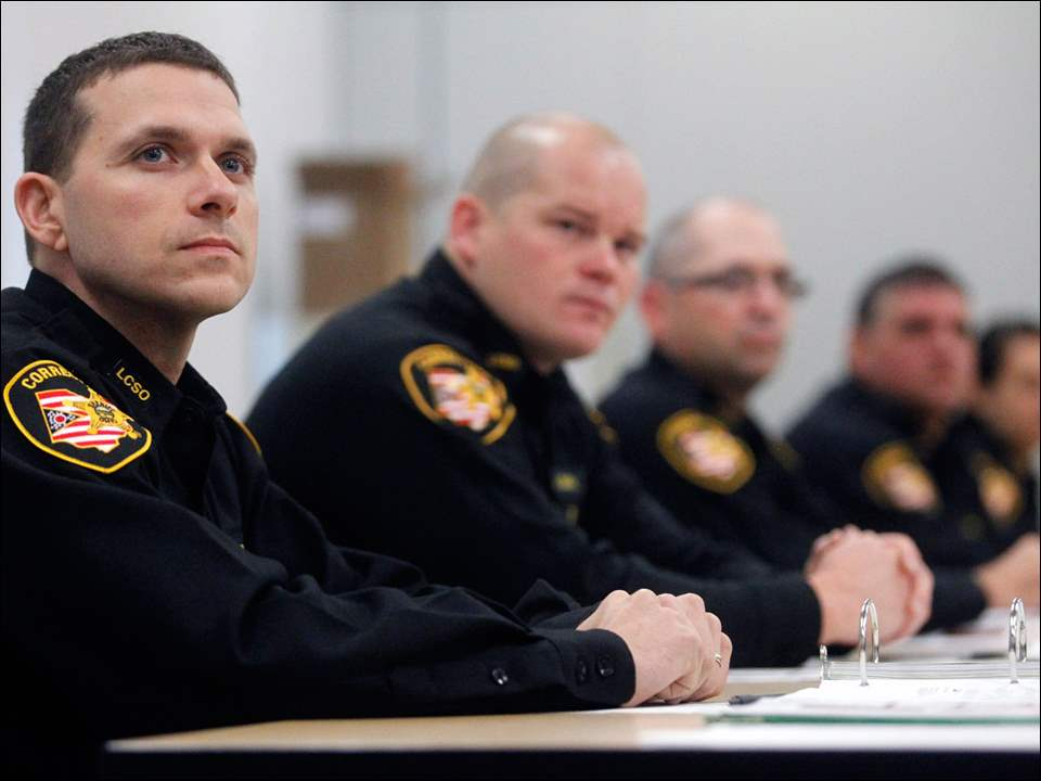 Lucas County Corrections Officer Andrew Smith listens.