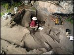 Sonia Zarriollo during an excavation at Cuncaicha rock shelter in the Peruvian Andes. Stone tools and other artifacts have revealed the presence of hunter-gatherers at about 14,700 feet above sea level, between 12,000 and 12,500 years ago in the Peruvian Andes.