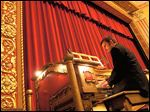 Steven Ball, former staff organist, plays the Barton Organ in 2006 at the Michigan Theater in Ann Arbor prior to its restoration. The rebuilt organ will be played by Stephan Warner on Saturday during the filming of 'Nosferatu.'