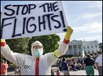 Jeff Hulbert, of Annapolis, Md., protests U.S. handling of Ebola cases outside of the White House Friday, Oct. 17, 2014, in Washington.