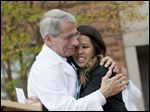 Patient Nina Pham is hugged by Dr. Anthony Fauci, director of the National Institute of Allergy and Infectious Diseases, outside of National Institutes of Health in Bethesda, Md., today.