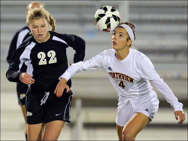 Sylvania Northview's Abbie Bacon (4) uses her head against Perrysburg's Hailey Wenzelman (22).